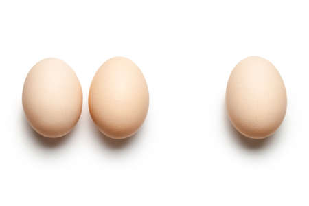 Chicken eggs on white background. Top view