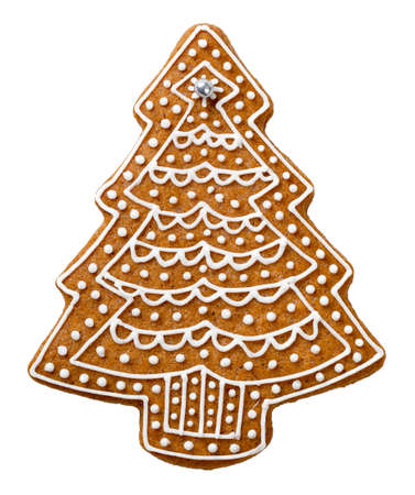 Gingerbread cookie in shape of tree for Christmas isolated on white background