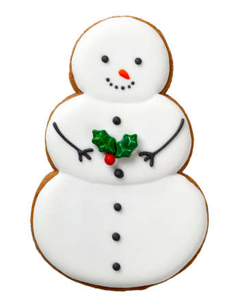 Christmas gingerbread cookie isolated on white background. Snowman shape cookie Stock Photo