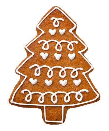 Gingerbread cookie for Christmas isolated on white background. Tree shape cookie