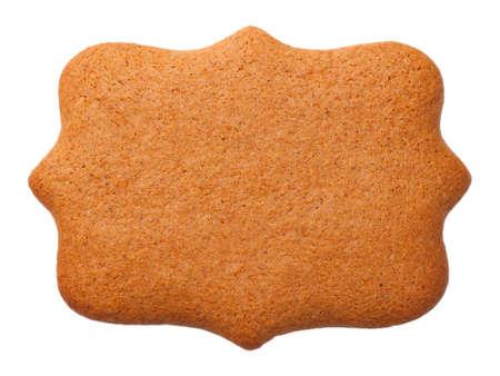 Peperkoekkoekje in vorm van etiket op witte achtergrond wordt geïsoleerd die. Bovenaanzicht Stockfoto