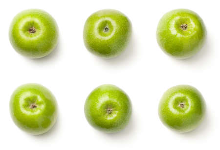 Green apples isolated on white background. The bottoms of granny smith apples. Top view Archivio Fotografico - 100182722