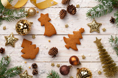 Christmas background with gingerbreads on wooden table.  Top view
