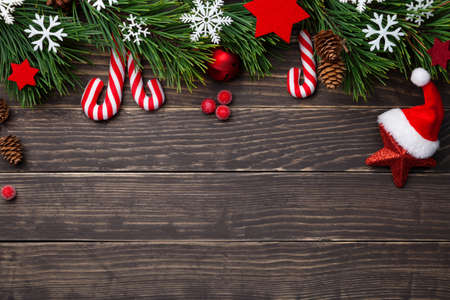 Christmas composition with decorations on wooden background. Copy space. Top view