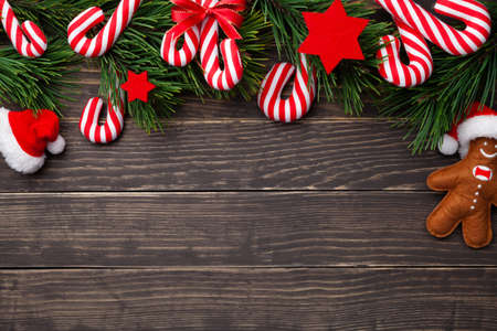 Christmas composition with candy canes on wooden background. Copy space. Top view