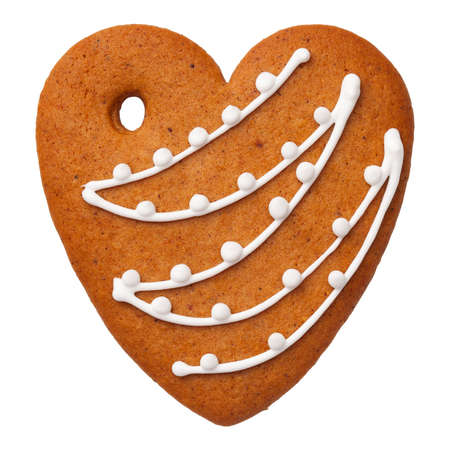Gingerbread heart cookie isolated on white background. Top view Stock Photo