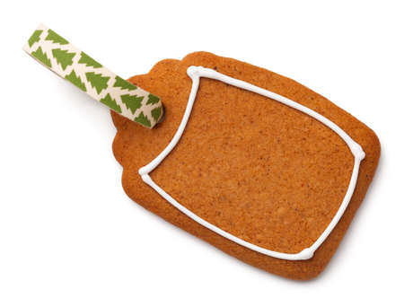 Gingerbread label cookie with ribbon isolated on white background. Top view Stock Photo