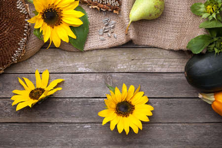 Autumn background with sunflowers on wooden table. Top view