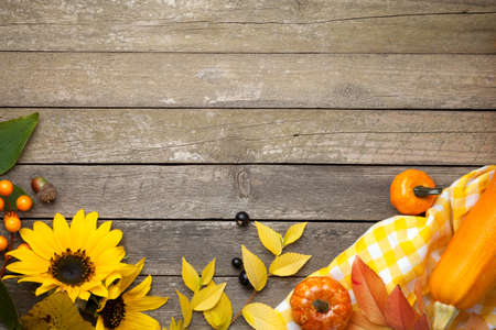 Autumn background on wooden table. Copy space. Top view