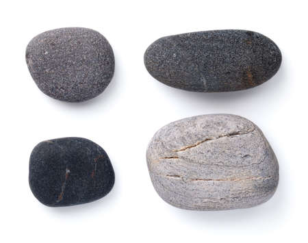 Set of various grey pebble stones isolated on white background. View from above