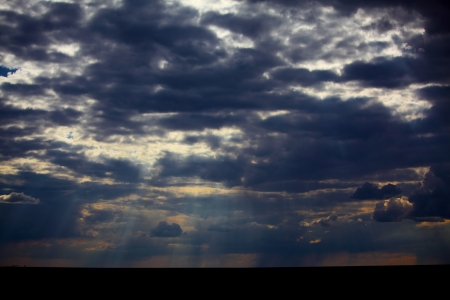 Beautiful dramatic sky with sun rays photo