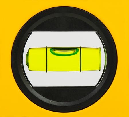 Groene waterpas close up, geïsoleerd op wit Stockfoto