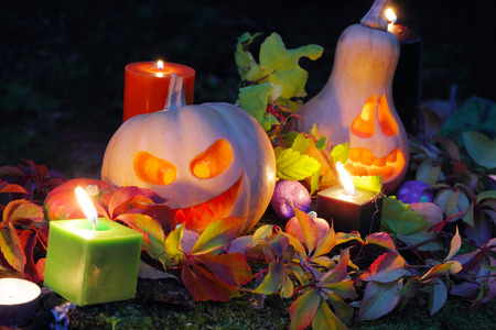 Halloween pumpkin lanterns with autumn leaves and candies photo