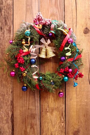 Christmas wreath with golden bells on the wooden background Stock Photo - 24354834