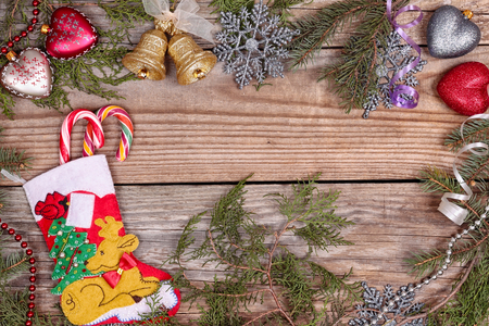 Christmas evergreen branches frame with christmas decoration on the wooden background Stock Photo - 24354848