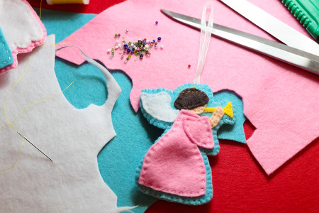 The process of making of handicraft felted angel figure photo