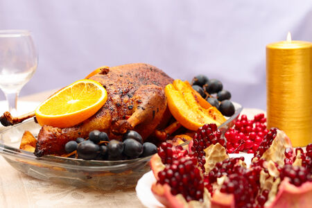 Roast duck with orange, served on a festive table photo