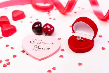 Heart shaped gift box, candies and valentine day decorations photo