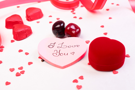 Heart shaped gift box, candies and valentine day decorations Stock Photo - 24646311