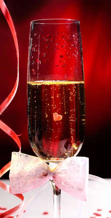 Glasses of champagne with Valentine Day decorations photo