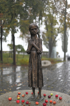 famine: UKRAINE, KIEV - october 20, 2010: Hungry girl bronze monument, symbol of Victims of Famine devoted to genocide victims of the Ukrainian people of 1932-1933 years on March 19, 2011, in Kiev, Ukraine