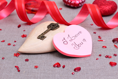 Valentine's day card with heart symbol and decorations photo