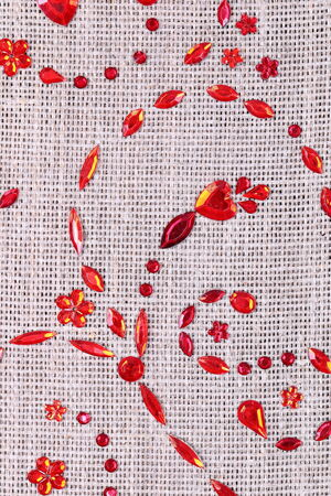 sequins floral ornament on the fabric texture Stock Photo - 25216396