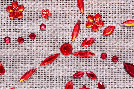 sequins floral ornament on the fabric texture Stock Photo - 25192344