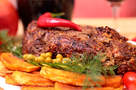 Appetizing roasted fillet of pork with spices and vegetables photo
