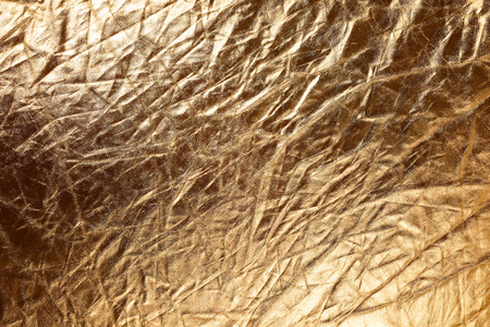 Texture of golden metallic fabric as abstract  photo