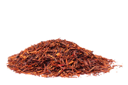 stimulator: rooibos tea isolated on the white background, selective focus