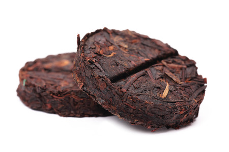 Organic raw Puer tea Chinese isolated on white background, selective focus photo