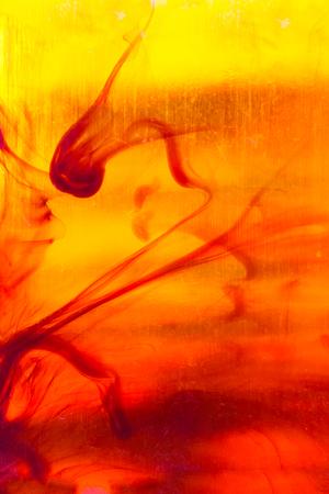 Liquid amber abstract background, close up macro photo