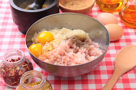 Minced fish in the bowl with spices and seasonings photo