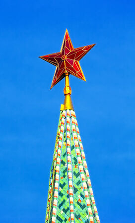 Red ruby star. Moscow Kremlin tower on the blue sky background photo