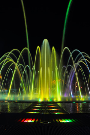 krasnodar: Musical fountain with colorful illuminations at night. Russia, Krasnodar Stock Photo