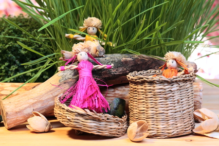 still-life with straw dolls and decorations photo