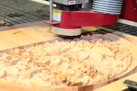 billet: CNC drilling machine is machining wood billet