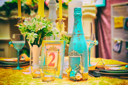 floral decoration: Flower and candle decoration for a wedding, noise effect added