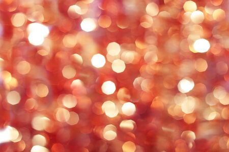 holiday ornament: Red and orange holiday bokeh as abstract background