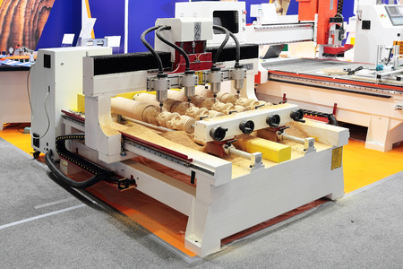 end mill: CNC milling machine making 4 wooden copies simultaneosly