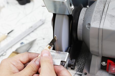 sharpening: Sharpening the metal cutter on the grinding machine Stock Photo