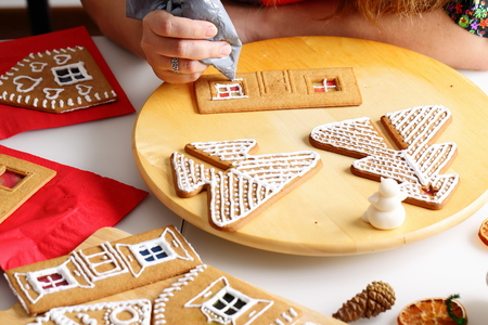 Making Of Christmas Gingerbread House. Walls Decorating. Stock Photo ...