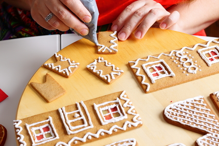 Making Of Christmas Gingerbread House. Chimney Decorating. Stock ...