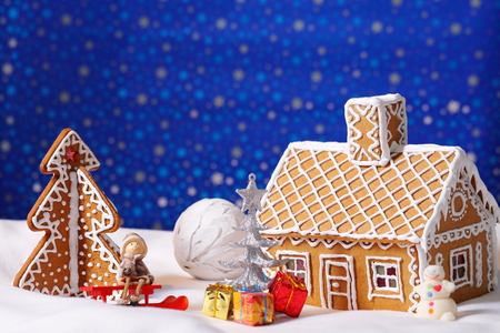 christmas house: Christmas card with gingerbread house and tree with decorations Stock Photo
