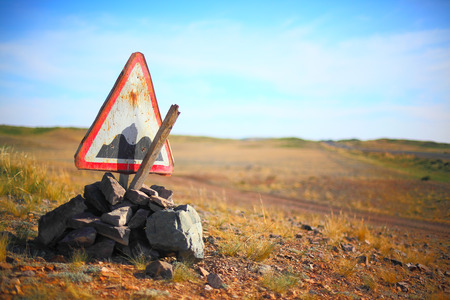 rough road: Broken rough road sign somewhere in Kazakhstan, Central Asia Stock Photo