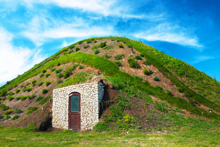 holiday blockbuster: Fairy hobbit hill wih door under the blue sky