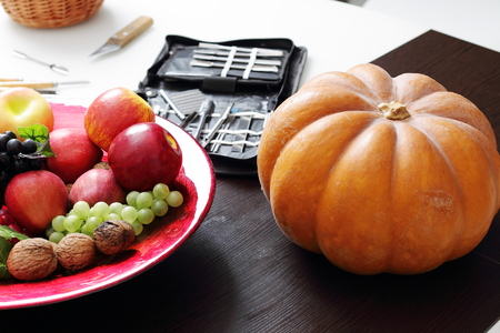 pumpkin carving: Still life with pumpkin, carving tools and autumn decorations Stock Photo