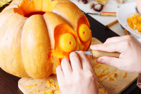 Process of carving out a pumpkin to prepare halloween lantern Stock Photo