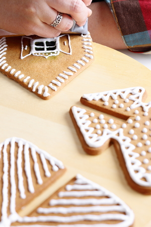 christmas house: Making of christmas gingerbread house. Walls decorating.